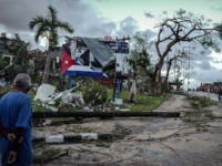 A resident of tornado-hit Regla neighbourhood looks at destroyed buildings, in Havana, on January 28, 2019. - A rare and powerful tornado that struck Havana killed three people and left 172 injured, Cuban President Miguel Diaz-Canel said early Monday. (Photo by ADALBERTO ROQUE / AFP) (Photo credit should read ADALBERTO …