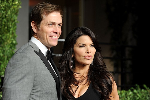 WEST HOLLYWOOD CA- FEBRUARY 27 Patrick Whitesell and Lauren Sanchez arrive at the Vanity Fair Oscar party hosted by Graydon Carter held at Sunset Tower
