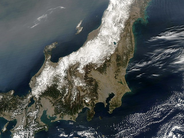 IN SPACE, JAPAN - MARCH 13: In this handout image provided by NASA, a satellite view of northeastern Japan following a massive earthquake captured March 13, 2011 at 03:55 UTC as seen from Space. An earthquake measuring 8.9 on the Richter scale has hit the northeast coast of Japan yesterday …