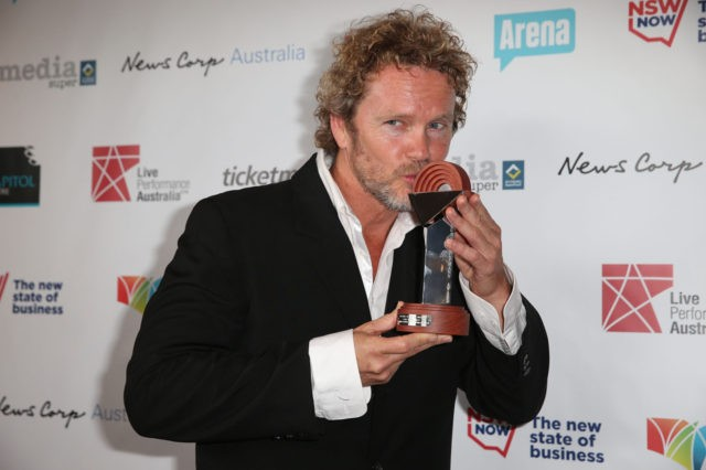 SYDNEY, AUSTRALIA - AUGUST 18: Craig McLachlan poses with the award for Best Actor in a Musical at the Capitol Theatre on August 18, 2014 in Sydney, Australia. (Photo by Mark Metcalfe/Getty Images)