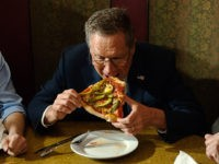 NEW YORK - MARCH 30: GOP Presidential Candidate John Kasich eats a piece of pizza at Gino's Pizzeria and Restaurant on March 30, 2016 in the Queens borough of New York City. Kasich is one of three remaining GOP Presidential Candidates fighting for New York's 95 Republican delegates in the …
