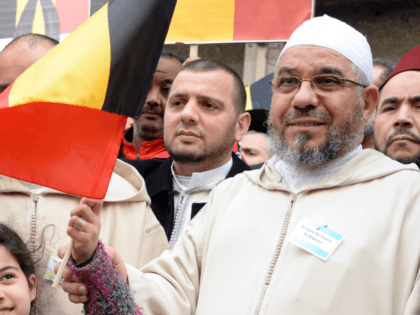 Members of the Muslim Community of Belgium, including Molenbeek Imam, Cheik Mohamed Toujgani (R), take part in a tribute, called by Muslim organizations, to the victims of the March 22 Brussels terror attacks on April 9, 2016, outside of Maelbeek / Maalbeek metro station, Brussels. On March 22, two bombs …