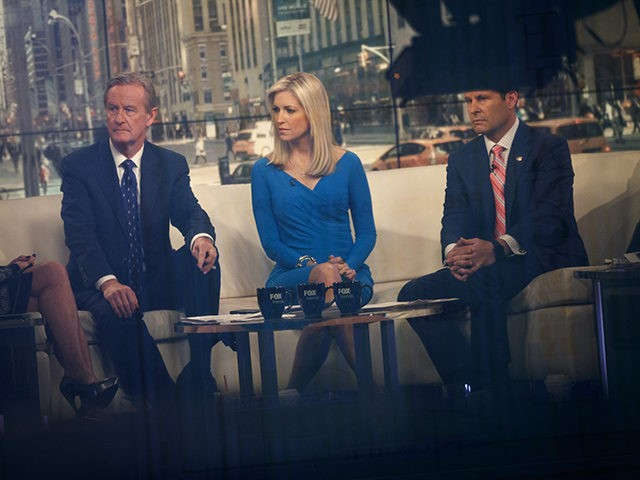 NEW YORK, NY - FEBRUARY 17: Seen through a window, (L to R) hosts Steve Doocy, Ainsley Earhardt, and Brian Kilmeade broadcast 'Fox And Friends' from the Fox News studios, February 17, 2017 in New York City. President Trump, a frequent consumer and critic of cable news, recently tweeted that …