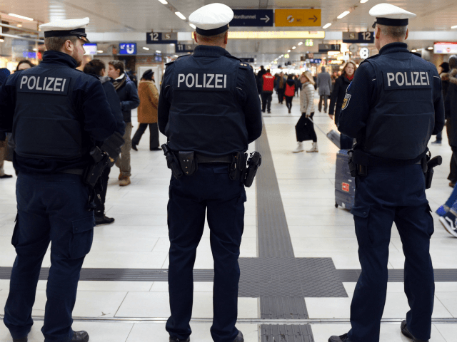 Policemen and passengers are seen in the main train station of Duesseldorf, western Germany, on March 10, 2017, one day after German police have arrested an axe-wielding attacker after he after he injured seven people. German police have arrested an axe-wielding attacker believed to be suffering from mental health issues …