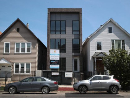 CHICAGO, IL - MAY 15: A newly-constructed home is offered for sale on May 15, 2017 in Chicago, Illinois. The National Association of Home Builders said today that its housing-market index rose by two points in May, a signal of a strengthening housing market. New home construction statistics for April …