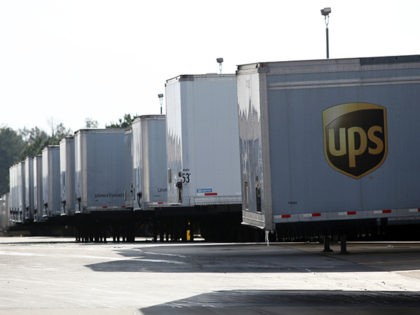 FOREST PARK - JANUARY 8: UPS trucks sit outside a UPS Customer Service Center on January 8, 2010 in Forest Park, Georgia. UPS announced today they would be cutting 1,800 jobs. (Photo by Jessica McGowan/Getty Images)