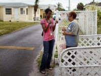 "MIAMI - APRIL 10: U.S. Census worker, Monique Stence, (L) gives the thumbs up to Nilda Borroto who had already returned her census form as they blanket a neighborhood during the ""March to the Mailbox"" effort on April 10, 2010 in Miami, Florida. The U.S. Census is using the ""March …"