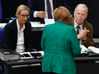 German Chancellor Angela Merkel (C) speaks to parliamentary group co-leaders of Germany's far-right Alternative for Germany (AfD) Alice Weidel (L) and Alexander Gauland (R) during a session at the Bundestag (lower house of parliament) on June 28, 2018 in Berlin. - Merkel warned that the migration challenge could determine Europe's …