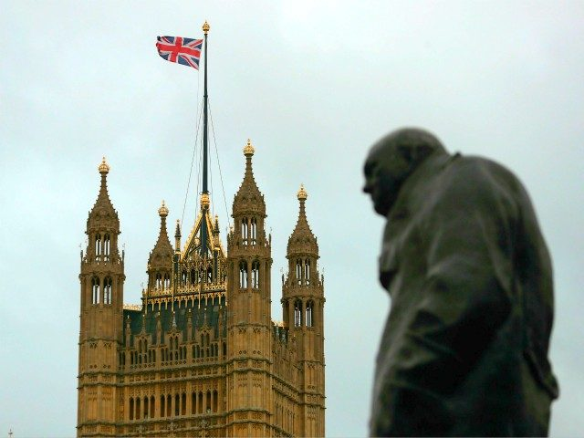 The Victoria tower of the Palace of Westminster that house the Houses of Parliament is seen next to a statue of Former British Prime Minister Winston Churchill in Westminster in central London on January 26, 2019. - Despite the humiliating rejection of Prime Minister Theresa May's Brexit deal, Britain is …