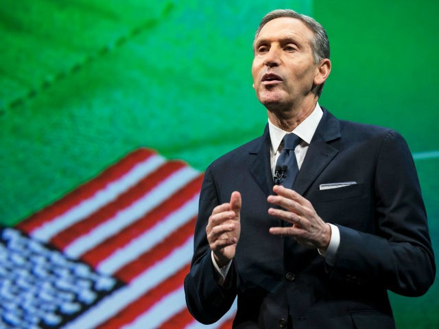 Starbucks Chairman and CEO Howard Schultz talks about the company's goal to hire 10,000 military veteran's and military spouses during the Starbucks annual shareholders meeting March 18, 2015 in Seattle, Washington. Schultz also announced a 2-for-1 stock split, the sixth in the company's history, during the meeting. (Stephen Brashear/Getty Images)