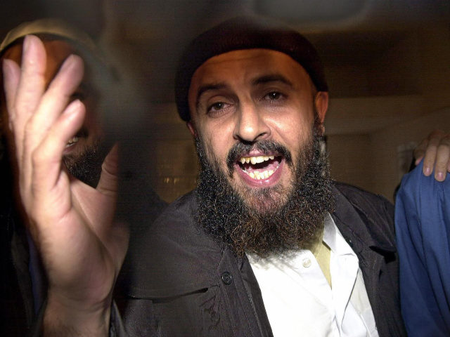 Jamal al-Badawi, a suspect of the USS Cole destroyer's bombing in 2000 in the Yemeni port of Aden, gestures after an appeal court announced his judgementto 15 years in prison in the final appeal session trial, 26 February 2005. The court upheld today one death sentence against an Al-Qaeda militant …