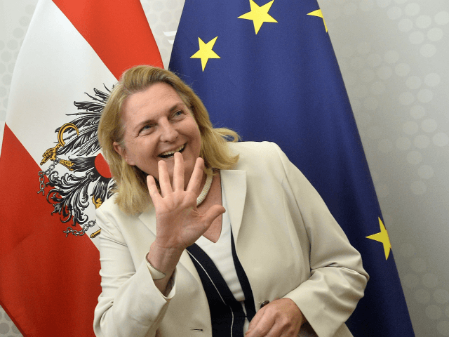 Austria's Foreign Minister Karin Kneissl (R) waves next to Britain's Foreign Minister Jeremy Hunt as they arrive to talk to the press as part of a meeting on August 1, 2018 in Vienna. (Photo by HERBERT PFARRHOFER / APA / AFP) / Austria OUT (Photo credit should read HERBERT PFARRHOFER/AFP/Getty …