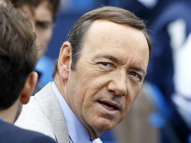 American actor Kevin Spacey watches Nicolas Mahut of France and Andy Murray of Britain play a tennis match at the Queen's Club grass court championships in London, Wednesday, June 12, 2013. (AP Photo/Kirsty Wigglesworth)