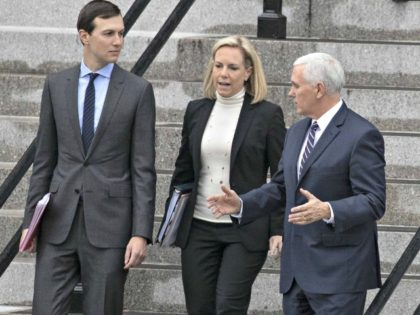 White House Senior Adviser Jared Kushner (left), Homeland Security Secretary Kirstjen Nielsen and Vice President Mike Pence talk as they walk down the steps of the Eisenhower Executive Office Building in the White House complex on Saturday, Jan. 5, 2019, in Washington