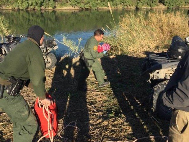 Laredo South Station agents rescue a 10-month-old boy and his mother from the Rio Grande River. (Photo: U.S. Border Patrol/Laredo Sector)