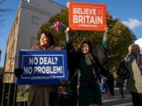 Activists hold up placards from the Leave Means Leave Pro-Brexit campaign group outside the Houses of Parliament in London on Janaury 8, 2019. - British MPs are set to hold a critical vote on January 15 on the Brexit agreement negotiated by Prime Minister Theresa May, her spokesman said on …
