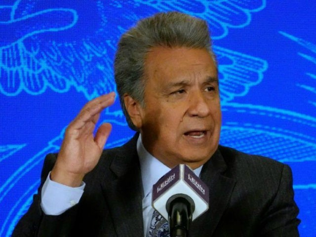 Ecuadorean President Lenin Moreno speaks during an interview with local press at Carondelet Palace in Quito on December 6, 2018, after Ecuadorean Vice-President Maria Alejandra Vicuna resigned. - Moreno said conditions met for Assange to leave the Ecuadorean embassy in London. (Photo by RODRIGO BUENDIA / AFP) (Photo credit should …