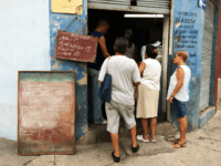 People waiting in line at a libreta store in Havana