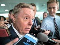 Sen. Lindsey Graham, R-S.C., a member of the Senate Judiciary Committee, responds to reporters after Sen. Jeff Flake, R-Ariz., a member of the committee, called for the FBI to investigate the sexual misconduct claims against Supreme Court nominee Brett Kavanaugh, on Capitol Hill in Washington, Friday, Sept. 28, 2018. Graham …
