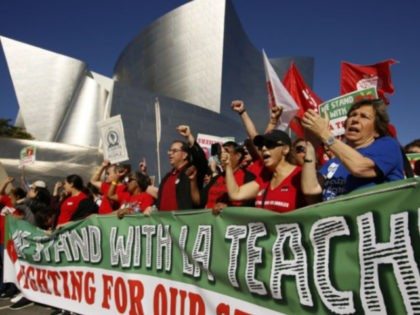 United Teachers Los Angeles leaders are joined by thousands of teachers, who may go on strike against the nation's second-largest school district next month, as they march past the Walt Disney Concert Hall in downtown Los Angeles Saturday, Dec. 15, 2018. The union contends that the district is hoarding a …