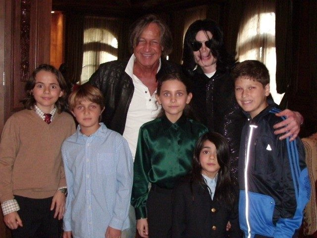 WESTWOOD, CA - NOVEMBER 27: In this handout photo provided by Mohamed Hadid, singer Michael Jackson (3rd R) poses with real estate developer Mohamed Hadid (3rd L), Hadid's children and Jackson's children Michael Joseph Jr. (L), Paris Michael Katherine (C) and Prince Michael II (2nd R) on November 27, 2008 …