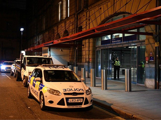 Police officers stand near a cordon at Manchester Victoria Station, in Manchester on January 1, 2019, following a stabbing on December 31, 2018. - A man, a woman and a police officer were being treated for knife injuries, police said Monday, after a stabbing at a railway station in the …