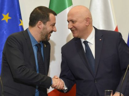 Polish Interior Minister Joachim Brudzinski (R) and Italian deputy Prime Minister and Interior Minister Matteo Salvini shake hands after their meeting in Warsaw on January 9, 2019. (Photo by Janek SKARZYNSKI / AFP) (Photo credit should read JANEK SKARZYNSKI/AFP/Getty Images)
