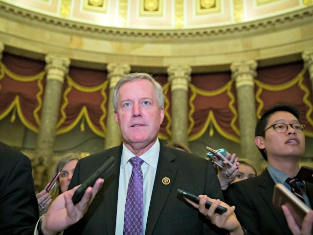 Rep. Mark Meadows, R-N.C., chairman of the House Freedom Caucus, walks as he speaks with reporters as they work to pass a bill that would pay for President Donald Trump's border wall and avert a partial government shutdown, on Capitol Hill, Friday, Dec. 21, 2018 in Washington.