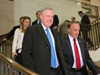 Rep. Mark Meadows, R-N.C., chairman of the conservative House Freedom Caucus, with Rep. Chris Collins, R-N.Y., right, heads into a House Republican strategy meeting with Vice President Mike Pence ahead of President Donald Trump's speech on funding a wall on the US-Mexico border, at the Capitol in Washington, Tuesday, Jan. …