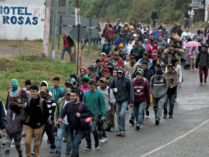 Honduran migrants walk along the roadside through Esquipulas, Guatemala, as they make their way toward the U.S. border, early Wednesday, Jan. 16, 2019. The latest caravan of Honduran migrants hoping to reach the U.S. has crossed into Guatemala.