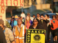 Members of the NAACP and their supporters start out for the first day of Journey for Justice, seven-day 120-mile march from the Canfield Green apartments where Michael Brown was killed to the Governor's mansion in Jefferson City, Missouri on November 29, 2014 in Ferguson, Missouri. The Ferguson area has been …