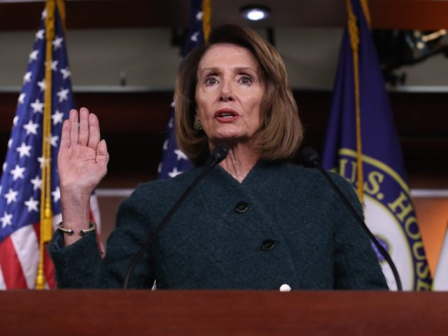 Nancy Pelosi takes the oath (Win McNamee / Getty)
