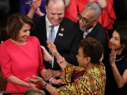WASHINGTON, DC - JANUARY 3: Members of Congress congratulate newly elected Speaker of the House Nancy Pelosi (D-CA) during the first session of the 116th Congress at the U.S. Capitol January 03, 2019 in Washington, DC. Under the cloud of a partial federal government shutdown, Pelosi reclaimed her former title …