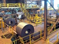 New rolls of sheet steel exit the spooling machine, and head off to cool down at the NUCOR Steel Gallatin plant, Wednesday, July 25, 2018, in Ghent, Ky. The plant, one of the largest sheet steel manufacturers in the US, has been operating 24 hours a day, seven days a …