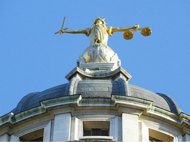 LONDON, UNITED KINGDOM: The statue of justice stands on the copula of the Old Bailey courthouse after Ian Huntley was sentenced to two life terms in prison for murdering 10-year-old school girls Holly Wells and Jessica Chapman and his girl friend Maxine Wells was convicted of preverting the course of …
