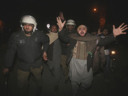 Pakistani police officers arrest a man at a protest against the acquittal of Asia Bibi, a Pakistani Christian woman who was facing blasphemy charges, in Lahore, Pakistan, Tuesday, Jan. 29, 2019. Pakistan's top court on Tuesday upheld its acquittal of Bibi. Radical Islamists protesters were stymied by sweeping arrests and …