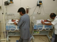 In this file photo taken Wednesday, Oct. 4, 2006, Pakistani hospital staff members attend newly born babies in Karachi, Pakistan. Anita Zaidi, a Pakistani doctor, won a $1 million grant Tuesday, Dec. 10, 2013, to fight early child mortality in a small fishing village in southern Pakistan in a contest …