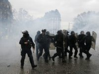 Police officers walk amidst the teargas after firing it during a demonstration by yellow vest protestors in Paris, Saturday, Jan. 26, 2019. Scattered skirmishes broke out amid mainly peaceful yellow vest marches Saturday in Paris and around France, as the movement kept up pressure on President Emmanuel Macron despite internal …