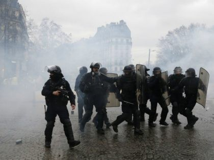 PICTURES: Tear Gas, Fires, and Riot Police at Paris Yellow Vest Protest