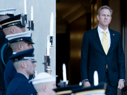 US Deputy Secretary of Defense Patrick Shanahan listens to the US National Anthem during an honor cordon outside the Pentagon on November 20, 2017 in Washington, DC. (Photo by Brendan Smialowski / AFP) (Photo credit should read BRENDAN SMIALOWSKI/AFP/Getty Images)