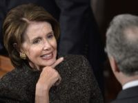 Pelosi throat slash (Brendan Smialowski / AFP / Getty)