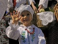 A Polish child arrives for an Easter Saturday blessing in a church in Bialy Dunajec on April 3, 2010. AFP PHOTO /JANEK SKARZYNSKI (Photo credit should read JANEK SKARZYNSKI/AFP/Getty Images)