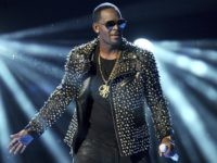 In this June 30, 2013 file photo, R. Kelly performs at the BET Awards in Los Angeles. Spotify's CEO says the company rolled out its new anti-hate policy in the wrong way. This month the streaming service announced it would remove music R. Kelly and rapper XXXtentacion from its playlists, …
