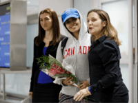 Asylum Seeker Rahaf Mohammed al-Qunun, 18, smiles as she is introduced to the media at Toronto Pearson International Airport, alongside Canadian minister of Foreign Affairs Chrystia Freeland, right, on January 12, 2019 in Toronto, Canada. Al-Qunun, a Saudi Arabian woman who fled her family saying she feared for her life, …