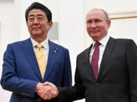 Russian President Vladimir Putin, right, and Japanese Prime Minister Shinzo Abe shake hands prior to their talks in the Kremlin in Moscow, Russia, Tuesday, Jan. 22, 2019.
