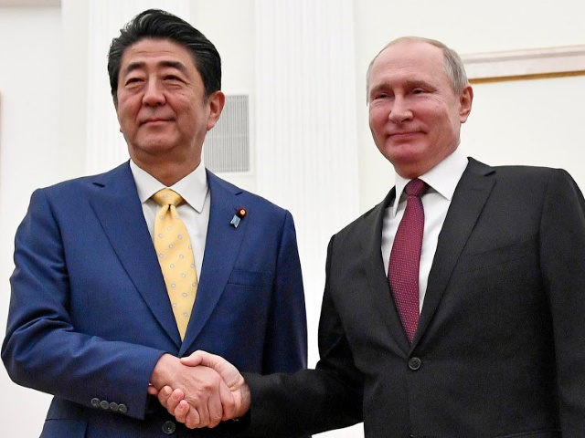 Vladimir Putin and Shinzo Abe seek to end wartime row over islands