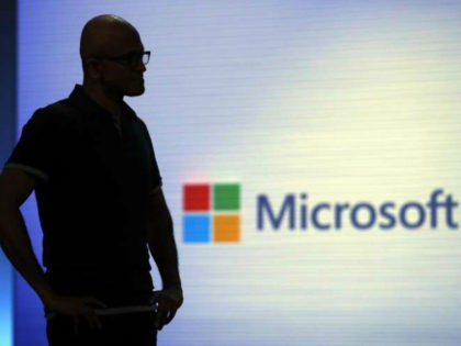 FILE- In this May 7, 2018, file photo Microsoft CEO Satya Nadella looks on during a video as he delivers the keynote address at Build, the company's annual conference for software developers in Seattle. Microsoft is threatening to overtake Apple as the world's most valuable publicly traded company. The market …