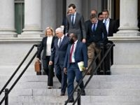 Homeland Security Secretary Kirstjen Nielsen, left, Vice President Mike Pence, White House legislative affairs aide Ja'Ron Smith, followed by White House Senior Adviser Jared Kushner, and others, walk down the steps of the Eisenhower Executive Office building, on the White House complex, after a meeting with staff members of House …