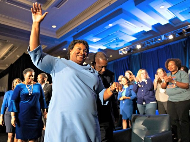 Georgia Democratic gubernatorial candidate Stacey Abrams leaves the stage after addressing supporters during an election night watch party, Tuesday, Nov. 6, 2018, in Atlanta.