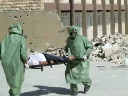 This image made from an AP video posted on Wednesday, Sept. 18, 2013 shows shows Syrians in protective suits and gas masks conducting a drill on how to treat casualties of a chemical weapons attack in Aleppo, Syria. The Islamic State group is aggressively pursuing development of chemical weapons, setting …